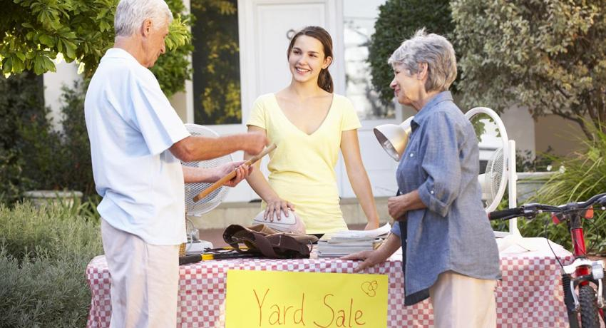 Elderly couple buying items at a yard sale