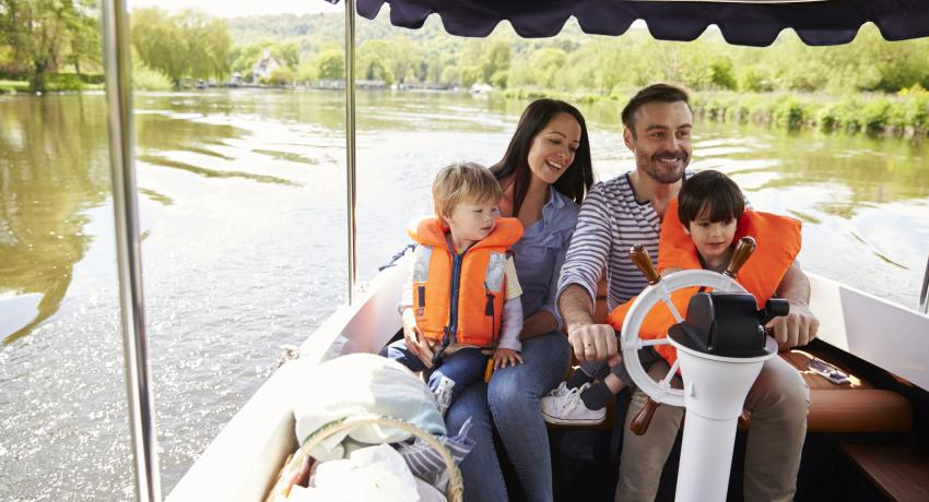 family riding on a boat