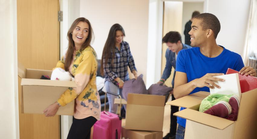 college students moving into dorm room
