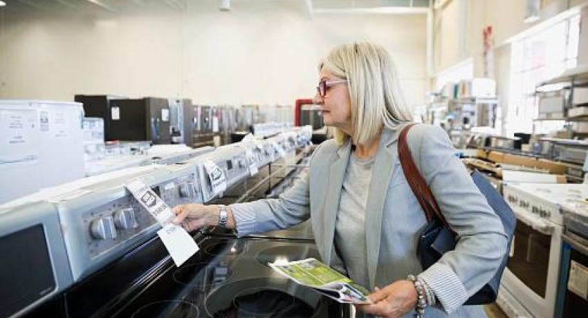 woman shopping weekday deal at appliance store